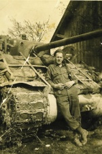 George DePuydt posing in front of his tank, WWII