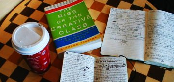 The Rise of the Creative Class on a chessboard with notes at a Starbucks on Thanksgiving Day, 2004