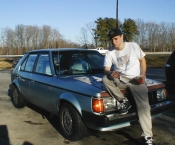 J. Nathan Matias posing with his 'Vintage' '89 Plymouth Horizon